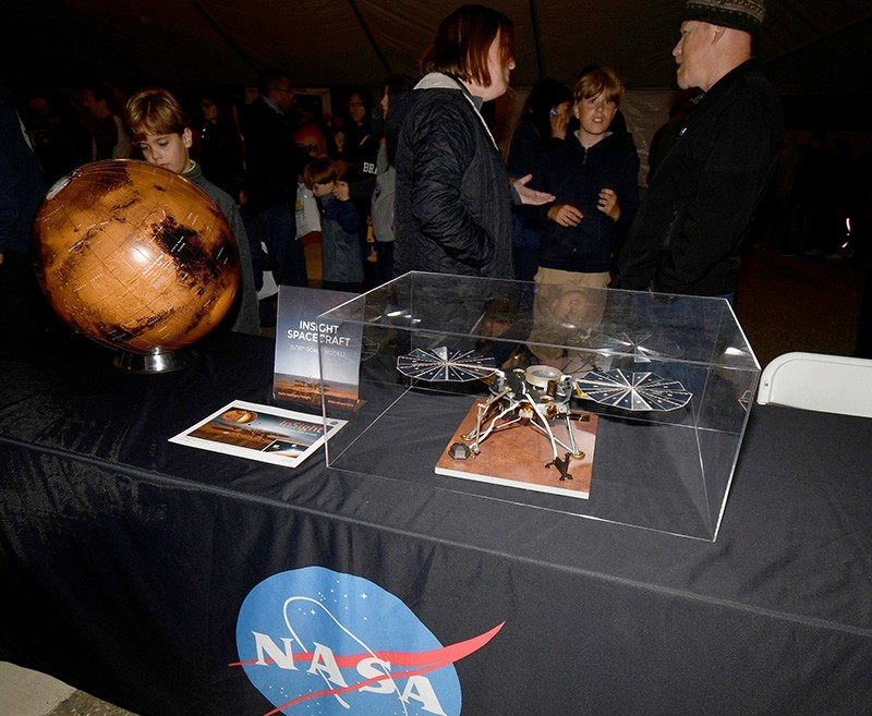 Visitors view a NASA display at the Lompoc Airport before the launch of a United Launch Alliance Atlas V rocket carrying NASA's InSight Mars lander, that lifted off from Vandenberg Air Force base in California, U.S., May 5, 2018. (Reuters Photo)