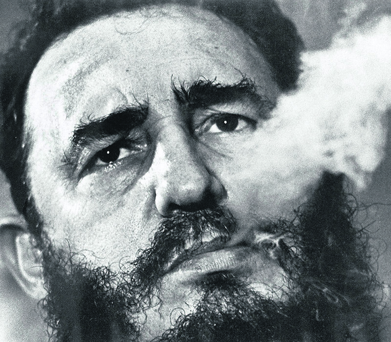 In a file photo  Fidel Castro exhales cigar smoke during a March 1985 interview at his presidential palace in Havana. (AP Photo)