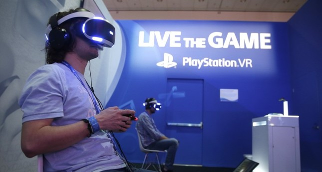 Gamers play the PlayStation virtual reality game The Inpatient on the opening day of E3 (Electronic Entertainment Expo) in Los Angeles.