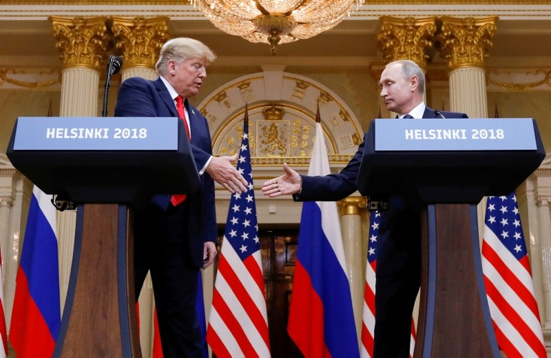 U.S. President Donald Trump and Russia's President Vladimir Putin shake hands during a joint news conference after their meeting in Helsinki, Finland, July 16, 2018. (REUTERS Photo)