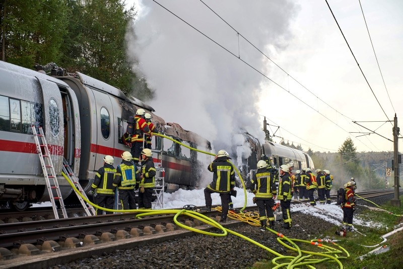 Firefighters extinguish a burning Inter City Express (ICE) train in the area of Diedorf, near Montabaur, Germany, Oct. 12, 2018. (EPA Photo)