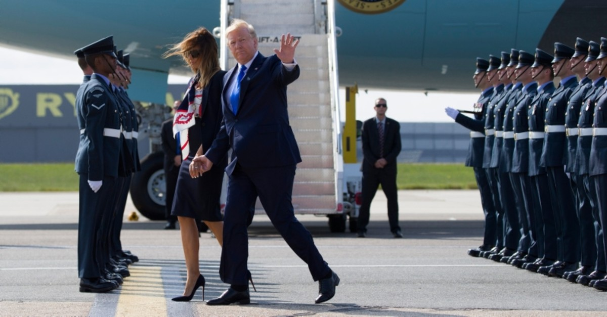 President Donald Trump waves as he and first lady Melania Trump arrive at Stansted Airport in England, Monday, June 3, 2019 at the start of a three-day state visit to Britain. (AP Photo)