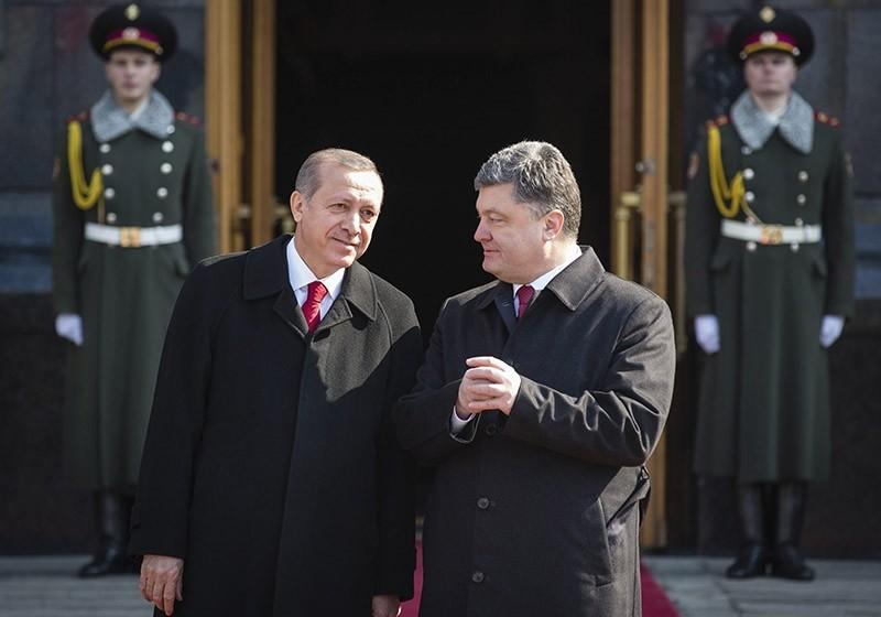 Recep Tayyip Erdou011fan (L) and Petro Poroshenko. AP Photo