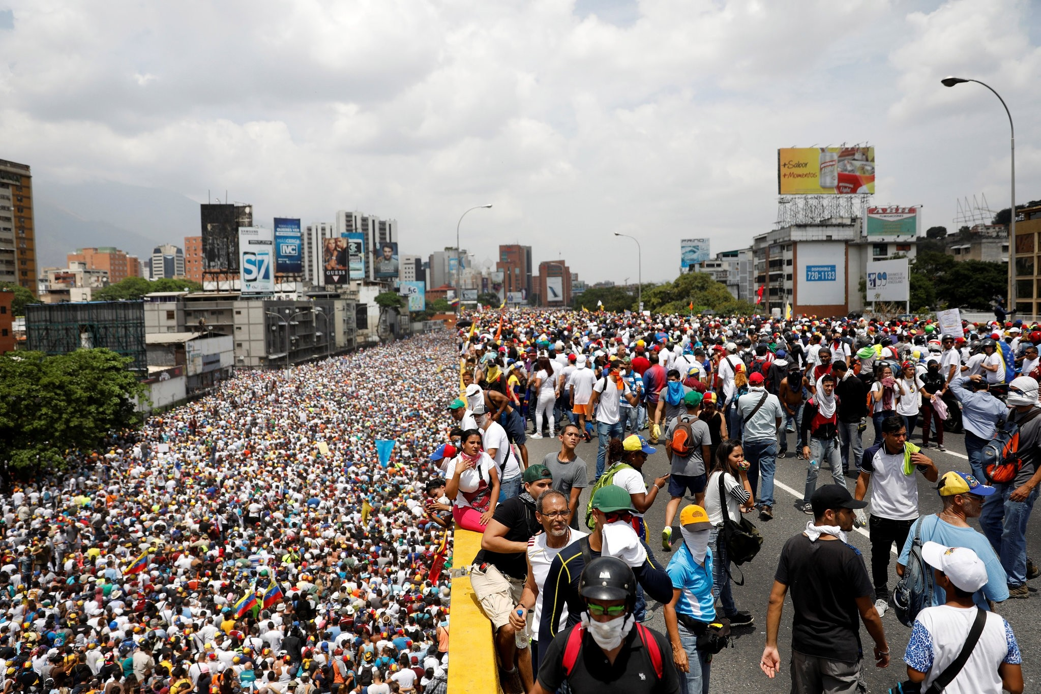 Hundreds of thousands of people march in Venezuela against Maduro. (REUTERS Photo)