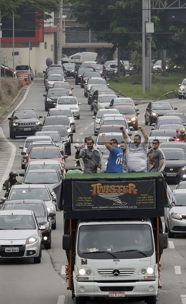 Uber drivers and other ride-sharing apps, protest against proposed regulation of those services by the Brazilian Senate.