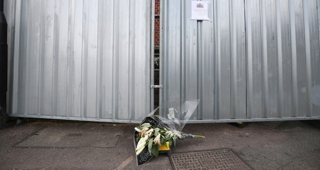Flowers are placed next to barriers outside the street where Dawn Sturgess lived before dying after being exposed to a Novichok nerve agent, in Salisbury, Britain, July 19, 2018. (Reuters Photo)