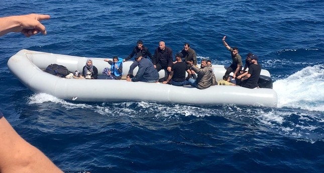 Coast Guard officers confront illegal migrants aboard a boat off the coast of Didim in Aydın province, June 1, 2019.