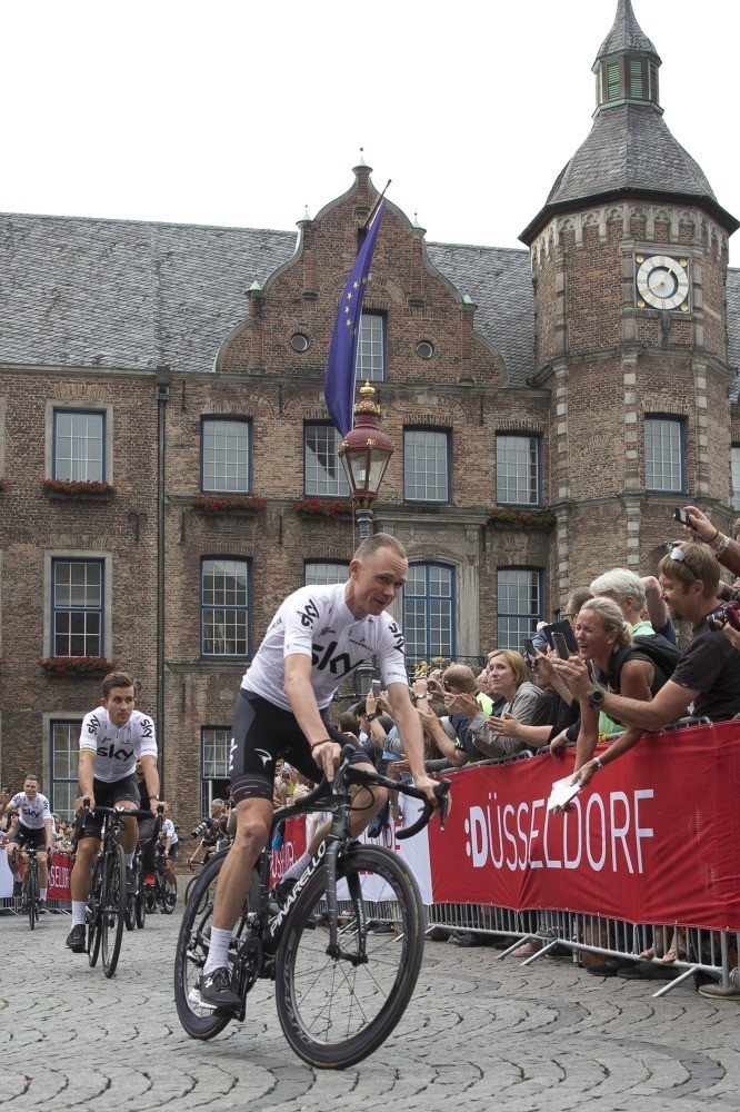Britainu2019s Chris Froome rides during the team presentation of the Tour de France cycling race in the center of Duesseldorf, Germany.