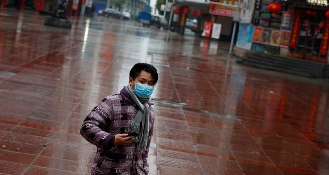 A man wearing a face mask walks in a deserted shopping area in Jiujiang, Jiangxi province, China, as the country is hit by an outbreak of the novel coronavirus, February 2, 2020. Reuters Photo