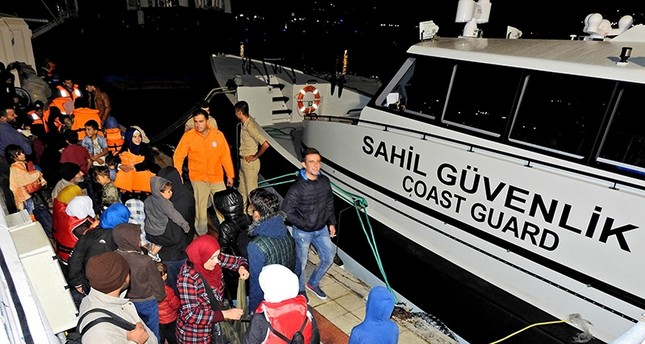 This file photo from Oct. 20, 2017 shows migrants captured by Turkish coast guard in Izmir province (DHA Photo)