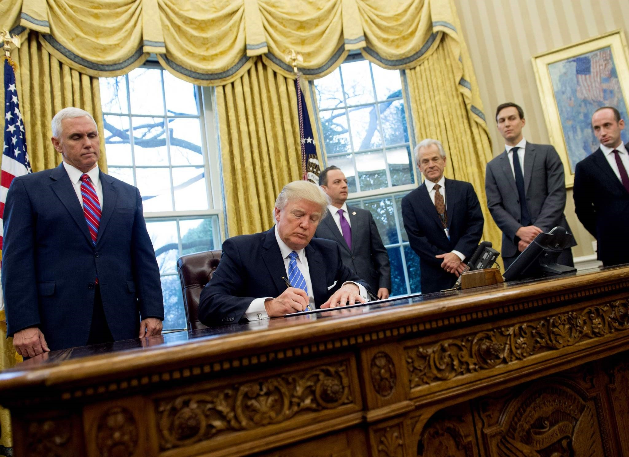 US President Donald Trump signing an executive order. (AFP Photo)