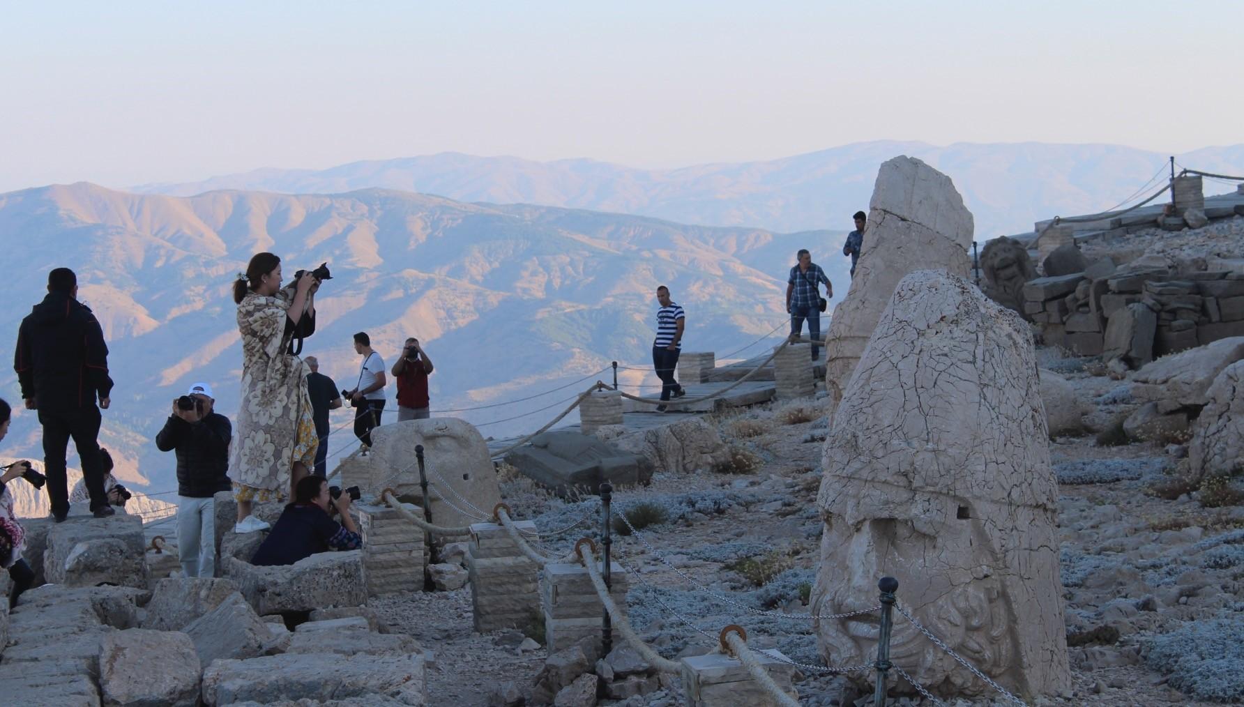 South Korean bloggers take photos at Mt. Nemrut.