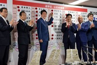 Abe's ruling coalition secures upper house majority in Japan elections