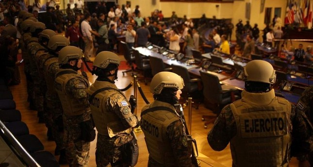 Soldiers stand inside the national congress as the president of El Salvador Nayib Bukele holds a special session, San Salvador, Feb. 9, 2020. REUTERS Photo