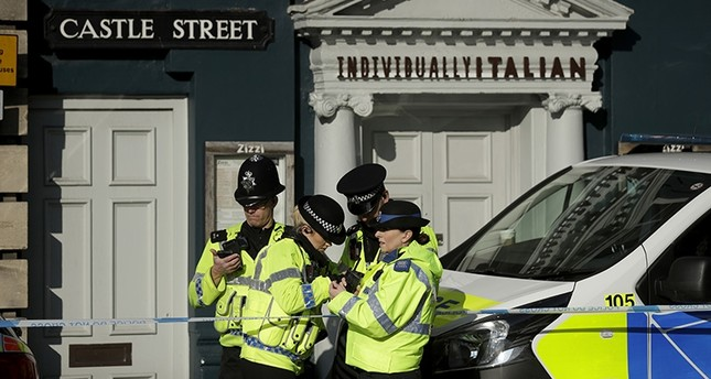Police officers stand outside a Zizzi restaurant in Salisbury, England, Wednesday, March 7, 2018, near to where former Russian double agent Sergei Skripal was found critically ill. (AP Photo)