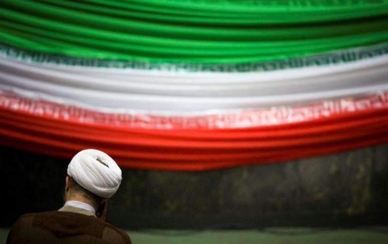 A lawmaker in the Iranian parliament during a ceremony in Tehran. (Reuters Photo)