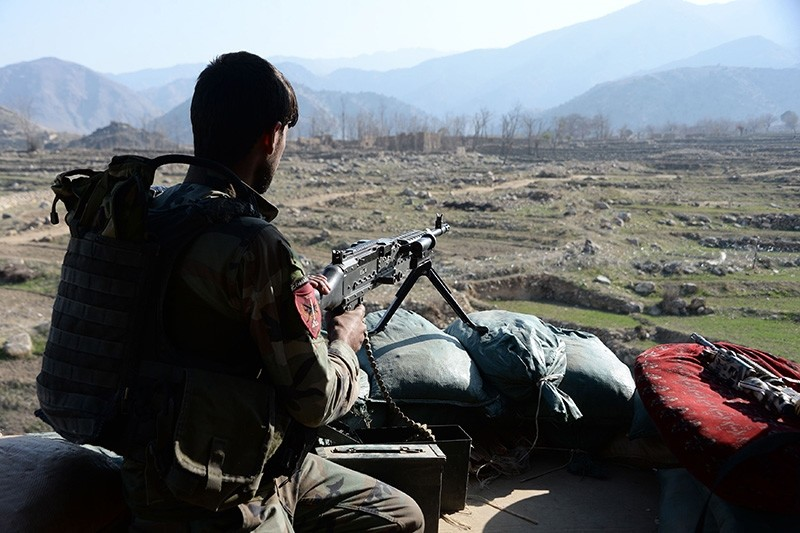 This file photo taken on January 3, 2018 shows an Afghan commando keeping watch during ongoing US-Afghan military operations against Daesh terrorists in Achin district of Nangarhar province. (AFP Photo)