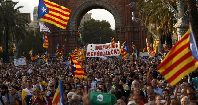 People with Catalan flags gather for a rally in Barcelona, Oct. 10.