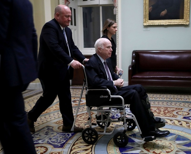 In this file photo taken on November 30, 2017, US Senator John McCain moves through the U.S. Capitol in a wheelchair in Washington, DC. (AFP Photo)
