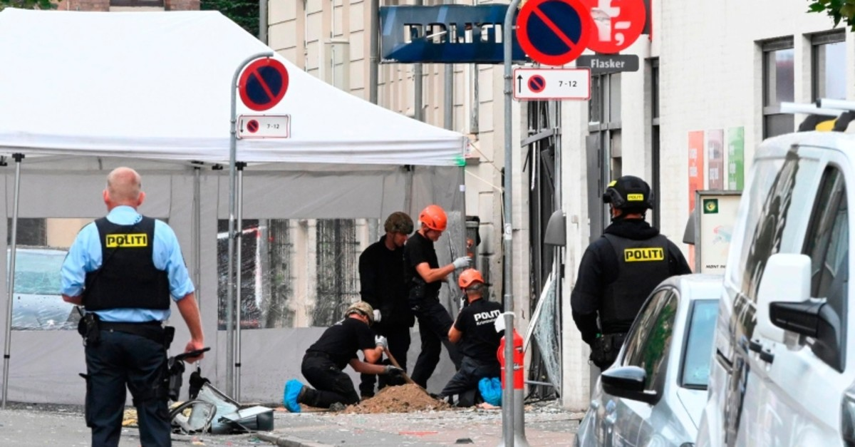 Danish police technicians work inspect the scene on Hermodsgade outside a local police station in Copenhagen on Aug. 10, 2019 (AFP Photo)