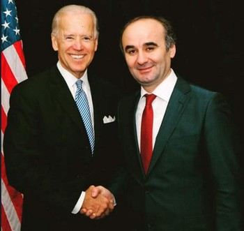 This file photo shows Kemal Öksüz shaking hands with former US Vice President Joe Biden.