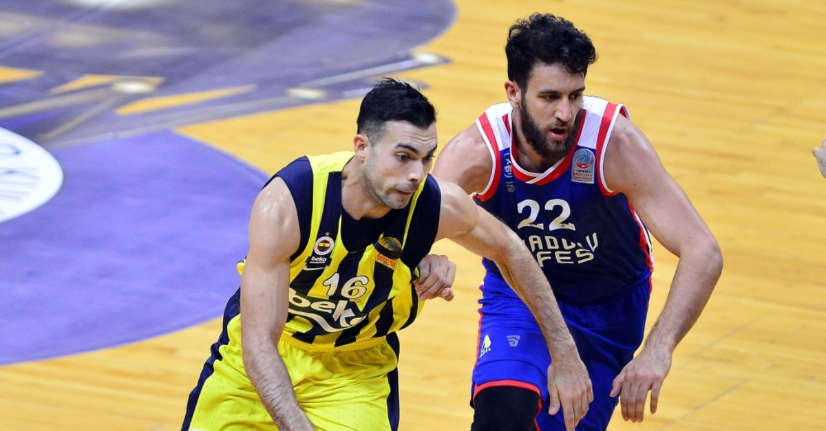Fenerbahu00e7e's Kostas Sloukas (L) in action with Anadolu Efes Vasilije Micic (R)in a previous game between two teams.