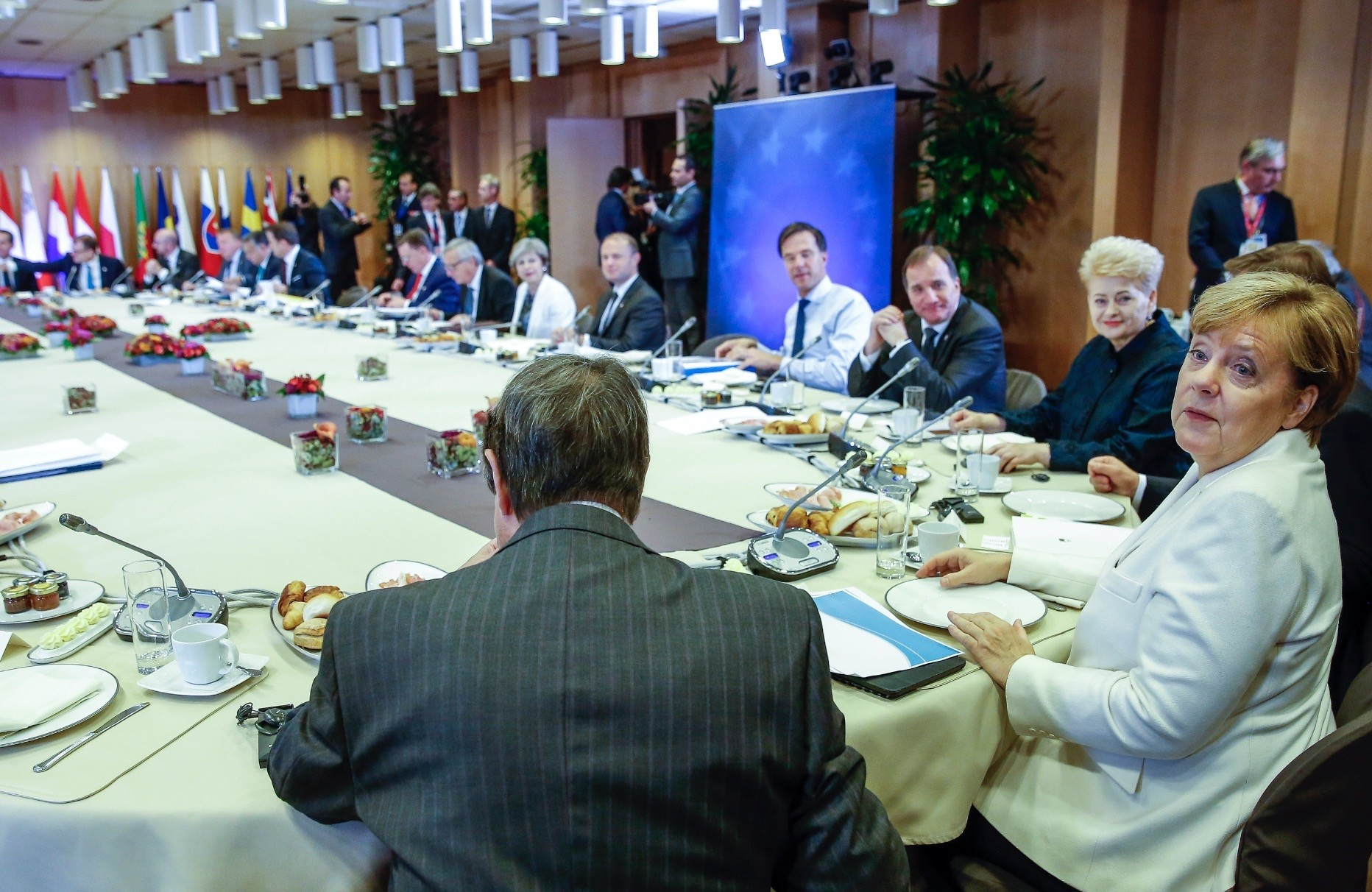Angela Merkel and other EU leaders in a breakfast meeting at an EU summit in Brussels Oct. 20. The German Chancellor said there is no majority that makes a decision on an immediate end to the negotiations with Turkey.