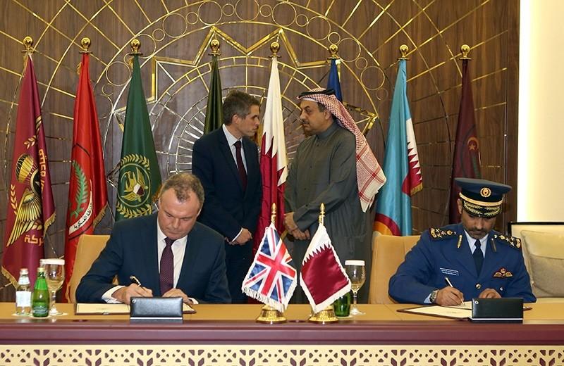 Britain's Defense Minister Gavin Williamson (C-L) talks to his Qatari counterpart Khalid bin Mohammed al-Attiyah (C-R) during an official agreement signing in the Qatari capital Doha on Dec. 10, 2017. (AFP Photo)