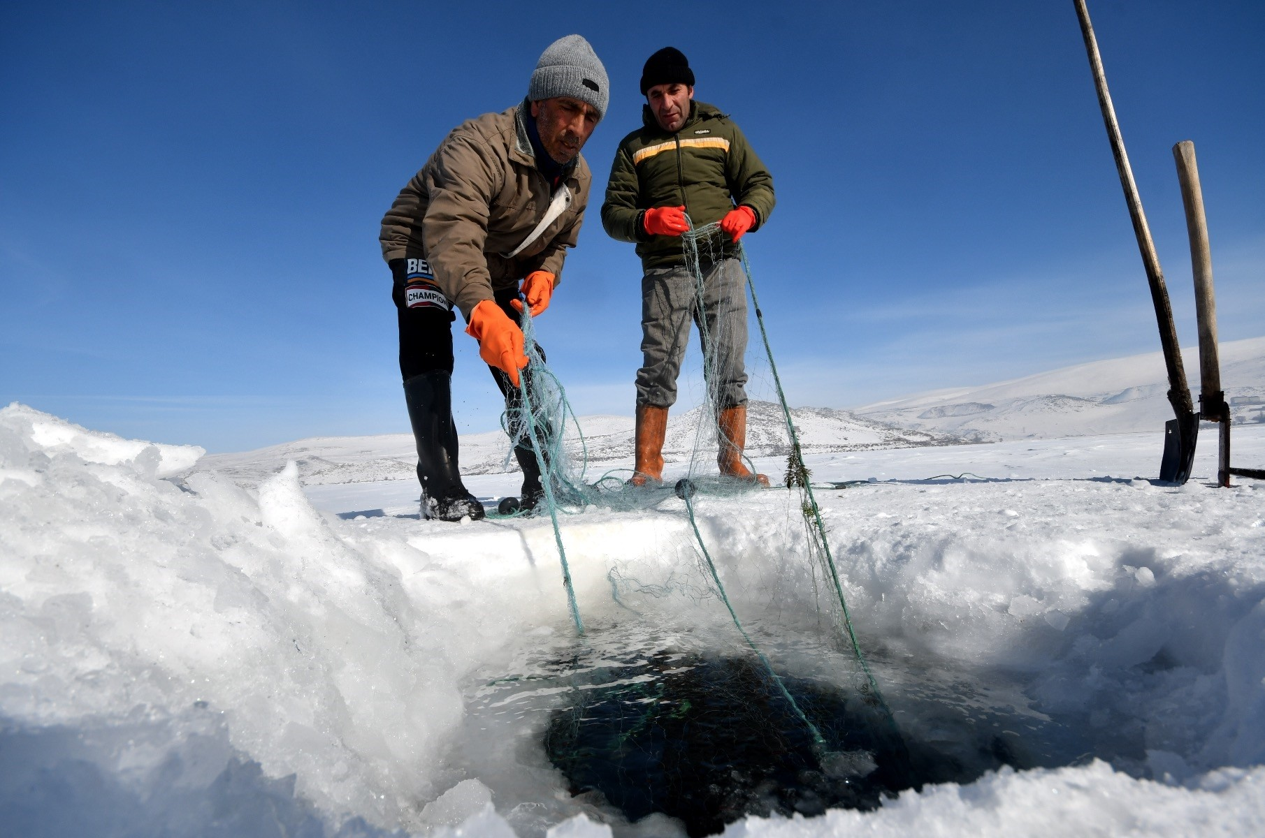 Breaking the ice with pickaxes and shovels, fishermen on Lake u00c7u0131ldu0131r give extra effort to fish.