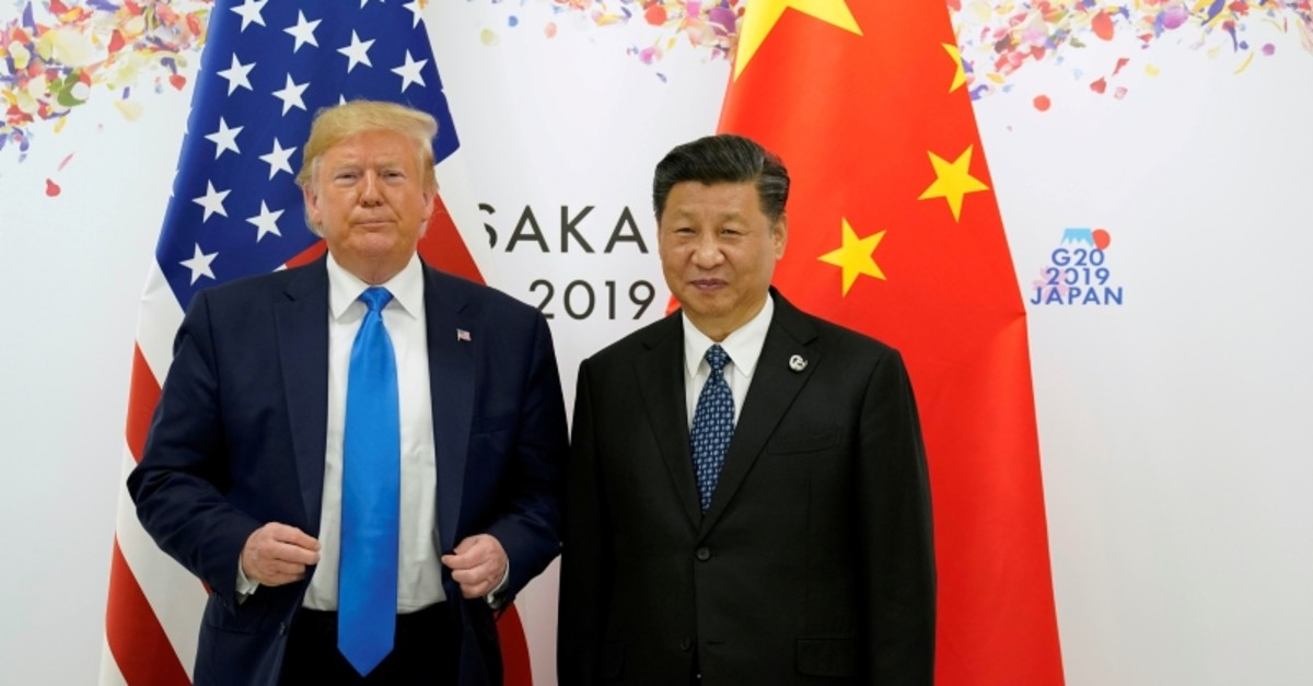 U.S. President Donald Trump and China's President Xi Jinping pose for a photo ahead of their bilateral meeting during the G20 leaders summit in Osaka, Japan, June 29, 2019. (Reuters Photo)