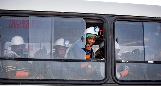 Miners who were trapped underground are transported to a safe holding area after being trapped underground at the Sibanye Stillwater's Beatrix mine, Welkom, South Africa, 02 February 2018 (EPA Photo)