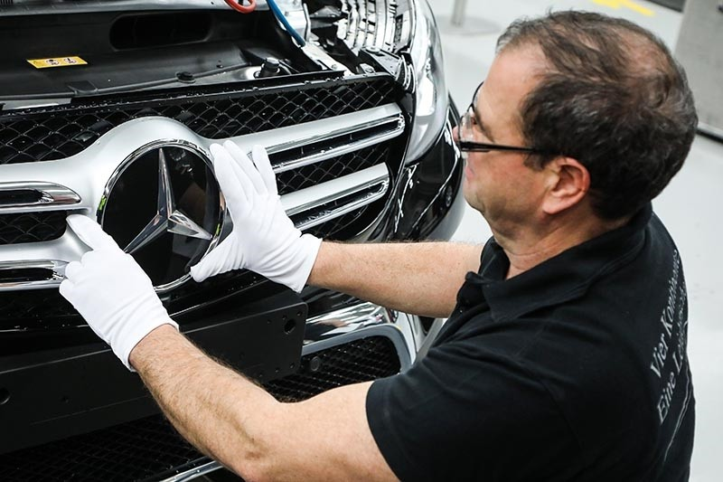 A worker attaches a Mercedes star at the C Class and GLC Class production line at the Mercedes Cars factory in Bremen, northern Germany, Jan. 24, 2017. (EPA Photo)