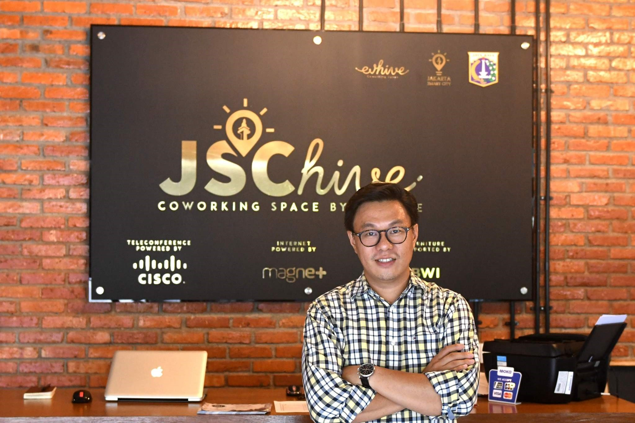 Willson Cuaca, one of the co-owners of the EV-Hive event space, a co-working space, in Jakarta.
