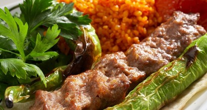 pFound just about anywhere in Turkey - and Turkish restaurants around the world - the Adana kebab, commonly known as the kıyma kebabı (minced meat kebab), is a long, charcoal-grilled meat kebab on...