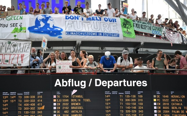 People throw paper planes during a Fridays for Future protest, claiming for urgent measures to combat climate change, at Stuttgart airport, Germany July 26, 2019 (Reuters Photo)