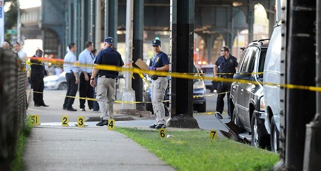Members of the New York City Police Department establish a crime scene at the spot where Imam Alala Uddin Akongi was killed. (Reuters Photo)