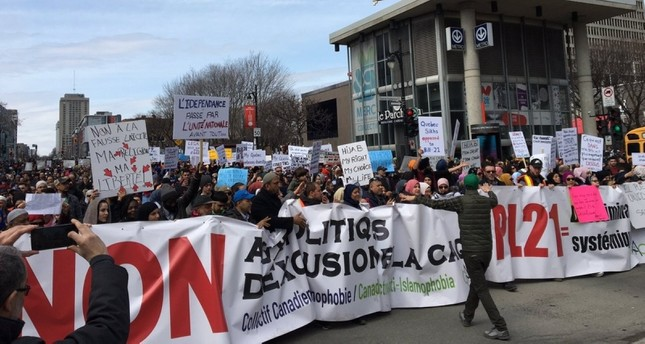 Demonstrators march to protest the proposal in Quebec, Canada. (IHA Photo)