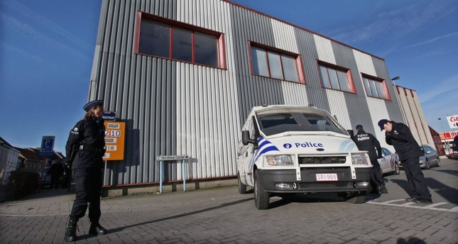 Police officers in Belgium stand outside offices of Roj TV in 2010 during an operation into the PKK-linked station, which is based in Denmark.