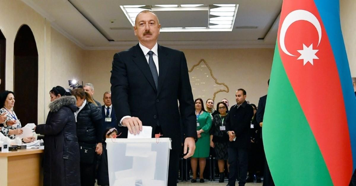 Azerbaijan President Ilham Aliyev casts his ballot at a polling station during parliamentary elections in Baku, Azerbaijan, Sunday, Feb. 9, 2020. (Azerbaijan Presidential Press Office via AP)
