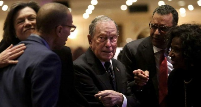 Michael Bloomberg (center) prepares to speak at the Christian Cultural Center on November 17, 2019 in the Brooklyn borough of New York City. (AFP Photo)