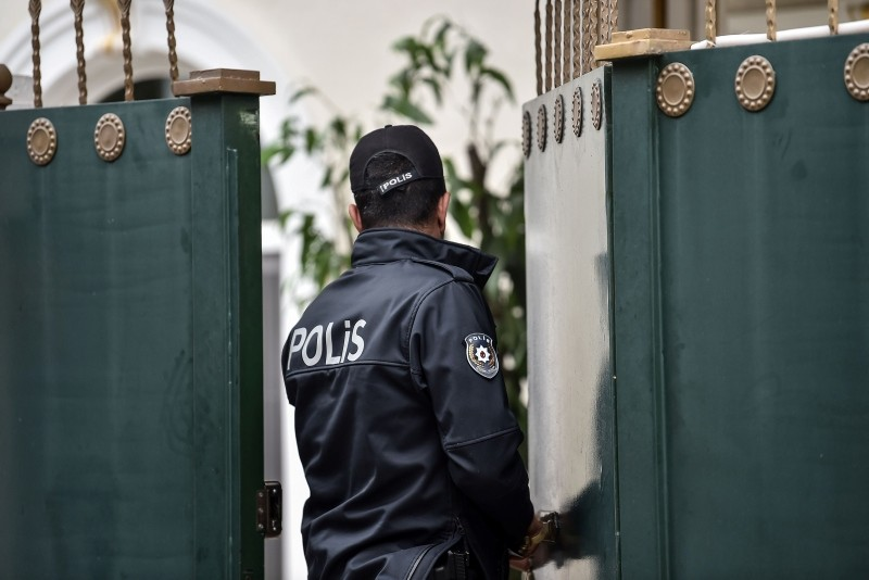 A Turkish police officer opens the door of Saudi Consul's residence on October 17, 2018 in Istanbul. (AFP Photo)