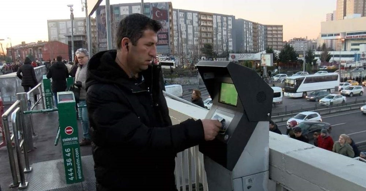 A commuter checking his bus fare card credits at a metrobus station in Cevizlibau011f district, Istanbul, Feb. 10, 2020. (DHA Photo)