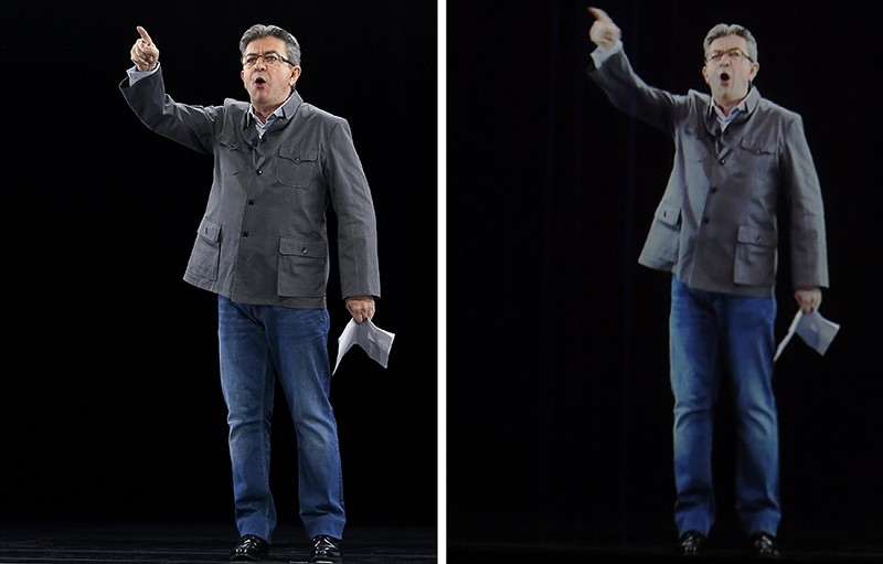 Melenchon and his hologram appeared in Lyon and Paris at same time during a double live rally. (REUTERS Photo)