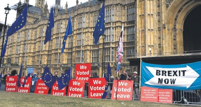 Pro-Brexit placards and EU flags are pictured outside the Houses of Parliament in London, Sept. 5, 2019.