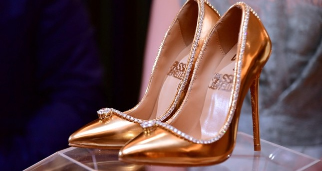 A pair of shoes worth 17 million US dollars are seen on display at Burj Al Arab during the launch presentation in Dubai on September 26, 2018. (AFP Photo)