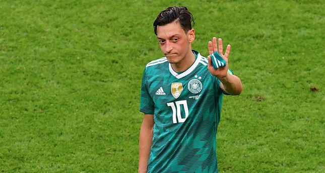 Germany's former midfielder Mesut Özil reacts at the end of the Russia 2018 World Cup Group F football match between South Korea and Germany at the Kazan Arena in Kazan on June 27, 2018.