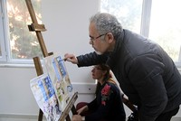 A Syrian refugee, who is a painter by profession, has been giving art lessons to Turkish students at a public education center in Turkey's southern Hatay province.