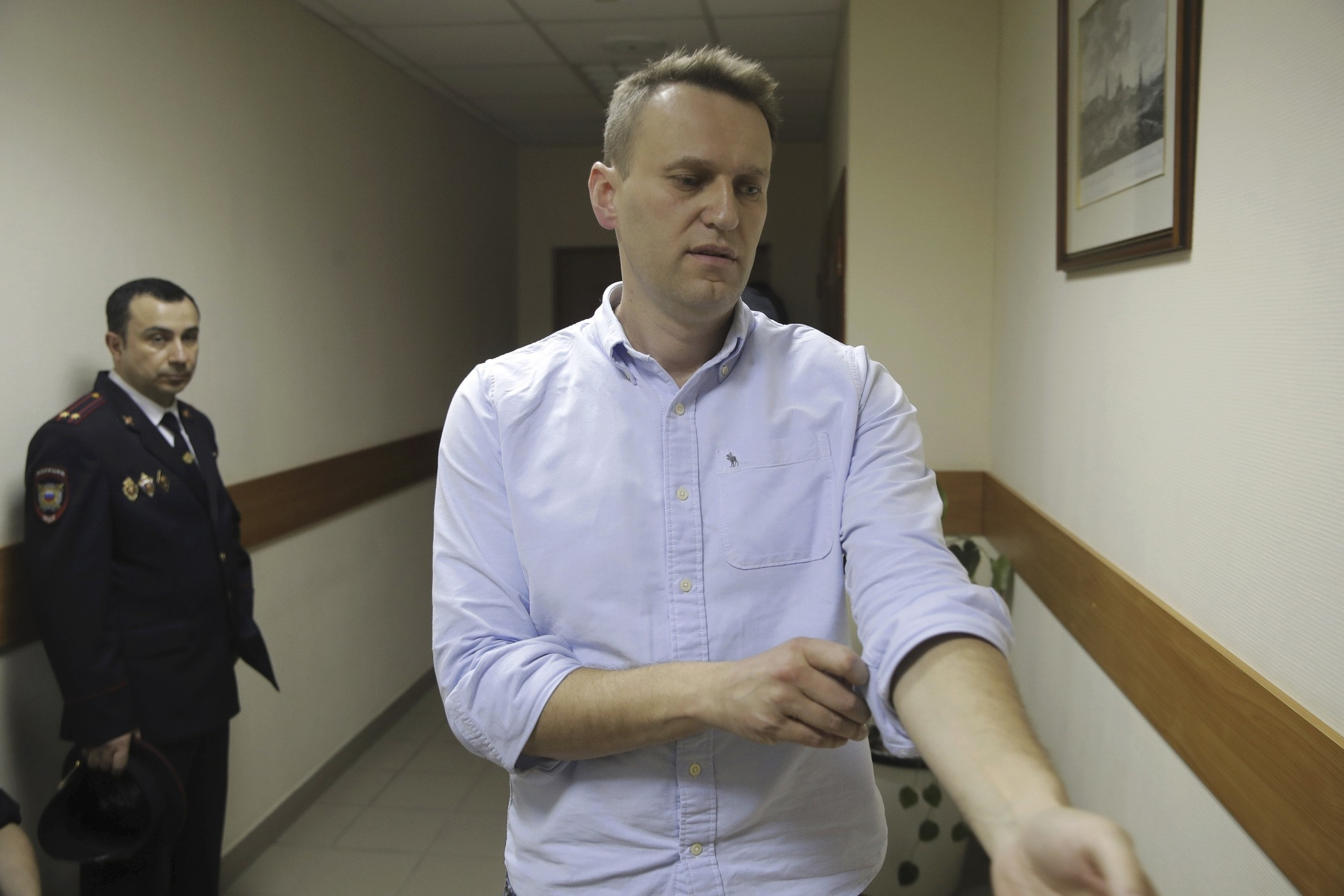Russian opposition leader Alexei Navalny walks before hearing in a court in Moscow, Russia, on Monday, June 12, 2017. (AP Photo)