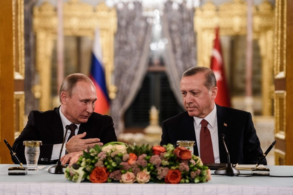 President Recep Tayyip Erdou011fan speaking to his Russian counterpart Vladimir Putin as they attend a press conference in Istanbul on Oct. 10, 2016.