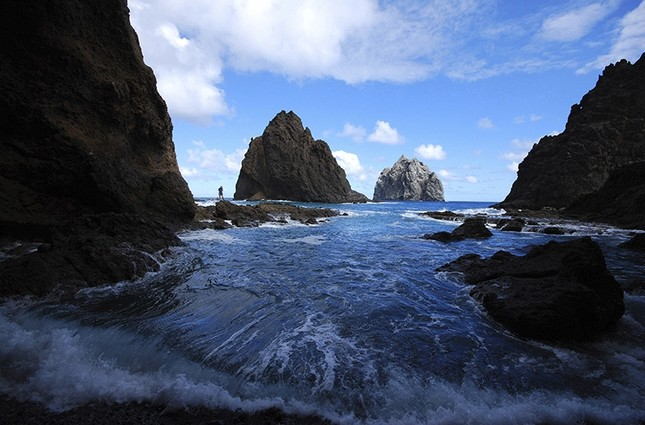 This January 2011 photo provided by St. Helena Tourism shows Devils Hole Black Rocks on the remote island of St. Helena. (AP Photo)